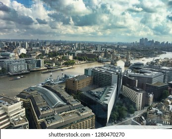 high up london skyline including tower bridge being lifted taken from southwark