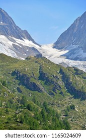 The high Lotschenlucke Pass in the Swiss Alps linking the Lotschtal Valley and the Aletsch Glacier and between the Mittaghorn and the Sattelhorn. Foreground Annenhutte, background Hollandiahutte
