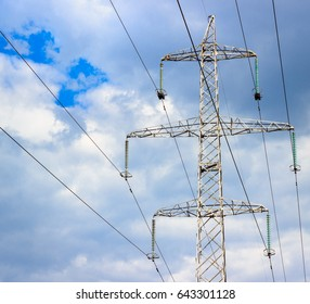 High metal construction against the sky, it's power lines, wires high above the ground, carefully high voltage
