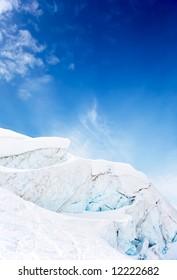 High mountain glacier over blue cloudy sky. Zermatt, Swiss, Europe.