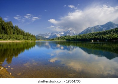 High mountain lake in the summers showing colors reflected in the water Americana