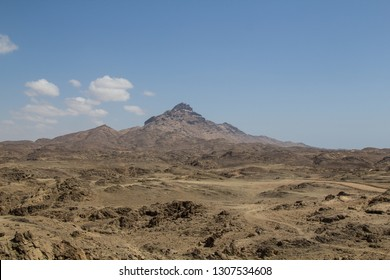 High mountain peak or dschebel between Sadah and Mirbat at the coastline of the Dhofar region of the Sultanate of Oman