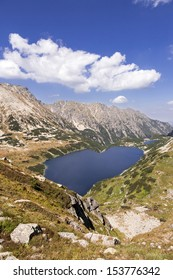 High mountain in Poland. National Park - Tatras. Ecological reserve.  Lake in the shape of a heart