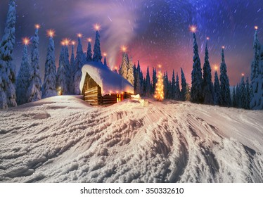 In the high mountains, among the wild forest huts located asylum shelters hunters and loggers over the moon that shines and illuminates the Milky Way galaxy, star and candle lit window