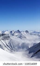 High mountains in haze. Caucasus Mountains, Georgia, region Gudauri.