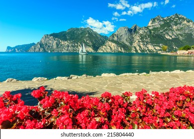 High mountains and sailing boat on the Lake Garda,Italy,Europe