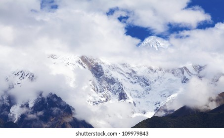 high mountains with snow and dramatic beautiful cloudy sky