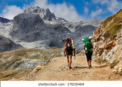 High mountains trekking two people Picos de Europa Cantabria Spain