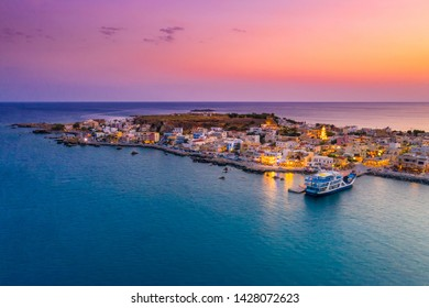High night view of traditional village of Paleochora at sunset, Chania, Crete, Greece.
