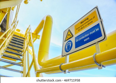 High noise alert sign, Protection equipment sign on petroleum offshore wellhead remote platform working area in the gulf or the sea, Energy and petroleum industry is major of the world.