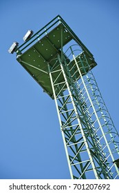 High observation tower against blue sky
