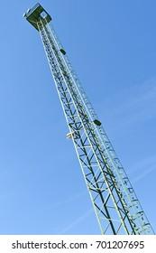 High observation tower against blue sky