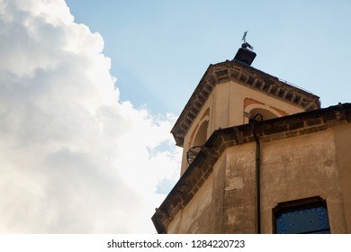 High part of church under the clouds, horizontal image
