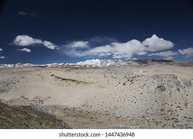 High pass at Himalaya mountains with snow capped mountains in the background and dark blue sky