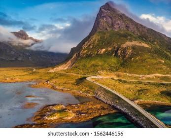 High peak near Fredvang Bridges, Fredvangbruene, are two cantilever bridges at dusk in Lofoten, Norway.