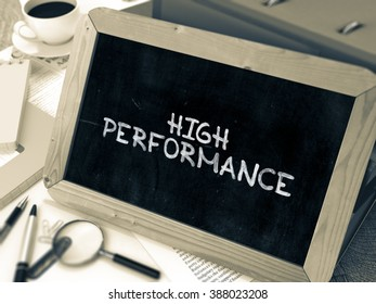 High Performance Handwritten on Chalkboard. Composition with Small Chalkboard on Background of Working Table with Ring Binders, Office Supplies, Reports. Blurred Background. Toned Image. 3D Render.