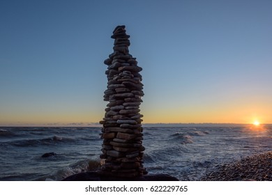 High pile of stones on the seashore in evening