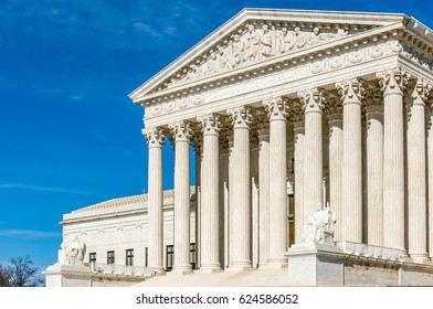 High pillars guard the entrance to the United States Supreme Court Building in Washington DC.