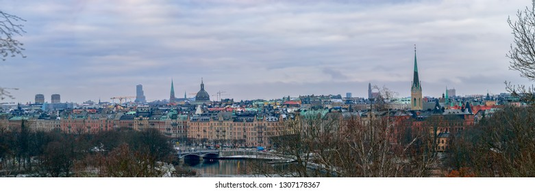 High point winter panorama of the Strandvagen Street on Ostermalm district seen from Djurgarden island across the water in Stockholm.