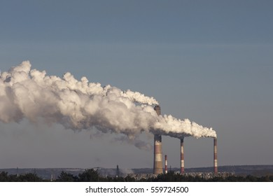 High pollution from coal power plant. Smoking chimney.