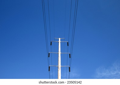 High Power electric lines and blue ski.