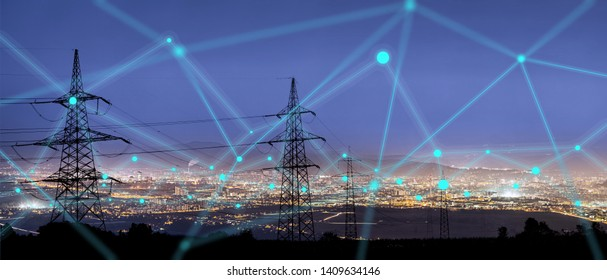 High power electricity poles in urban area connected to smart grid. Energy supply, distribution of energy, transmitting energy, energy transmission, high voltage supply concept photo.