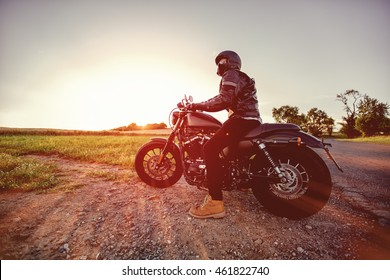High power motorcycle chopper during sunset.