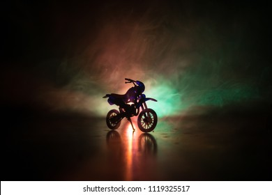 High power motorcycle chopper. Fog with backlights on background with man rider at night. Empty space. Selective focus