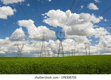 High Power Transmission Line. High power lines stretch far off to the horizon in the Palouse area of eastern Washington state. Electricity generated from Grand Coulee Dam distributed to Washington.