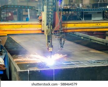 High precision CNC gas or plasma cutting metal sheet. Metal sheet and working plasma or gas plasma cutting machine