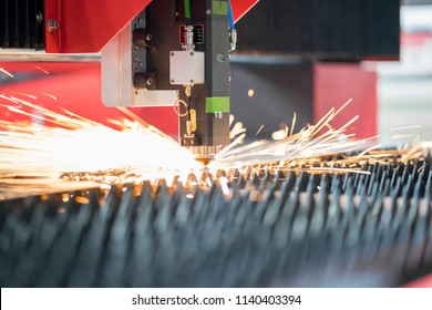 High precision CNC laser cutting metal sheet with bright sparkle in industrial factory