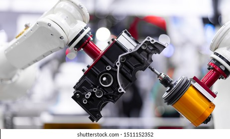 High precision CNC machining center independent axis movement  working, engineer control hand robot machining automotive sample part process in the industrial factory