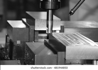 High precision CNC machining center working, operator machining die metal mold process