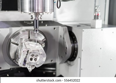 High precision CNC machining center 5 axis working, operator machining automotive sample part process in factory