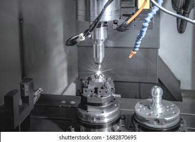 High precision CNC milling machine, operator machining metal part process in factory