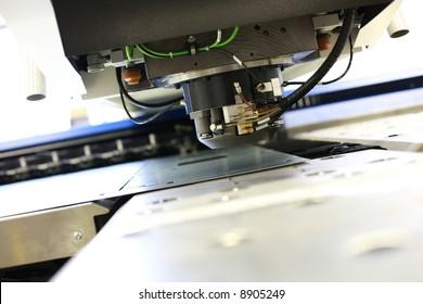 High precision CNC sheet metal stamping and punching machinery.