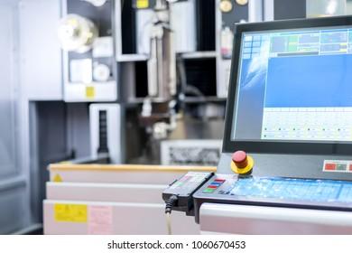 High precision CNC wire cut machine working, operator machining die metal mold process in factory