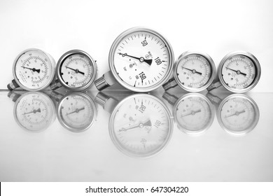 High pressure gauge meters or manometers for LNG or LPG natural gas distribution station plant or factory facility isolated on white background.Pressure gauge in oil and gas production process.