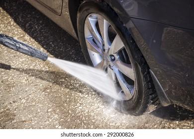 High pressure manual car washing outdoors