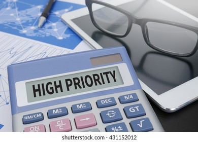 HIGH PRIORITY Calculator  on table with Office Supplies. ipad