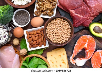High protein food - fish, meat, poultry, nuts, eggs and vegetables. healthy eating and diet concept. top view