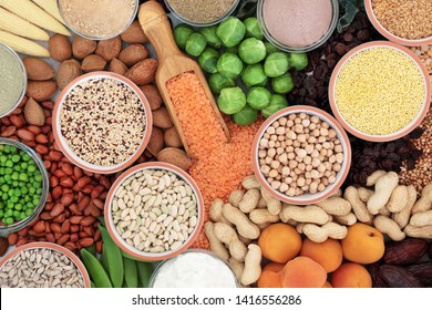 High protein health food selection with grains, vegetables, dried fruit, almond yoghurt, supplement powders, nuts  and seeds. High in dietary fibre, antioxidants and vitamins. Top view.