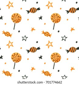 High quality hand drawn Halloween seamless pattern with candies and stars isolated on white background. Good for decor elements for halloween party.