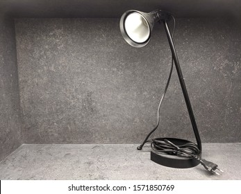 High Quality Image of an Unplugged Spotlight Desk Lamp on the Shelf