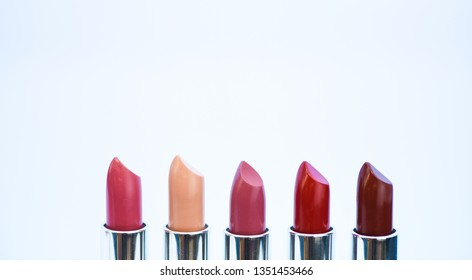 High quality lipstick. Cosmetics artistry. Lipstick for professional make up. Pick color which suits you. Compare makeup products. Lip care concept. Lipsticks on white background. Daily make up.