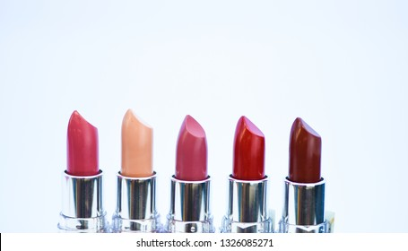 High quality lipstick. Daily make up. Cosmetics artistry. Lipstick for professional make up. Pick color which suits you. Compare makeup products. Lip care concept. Lipsticks on white background.