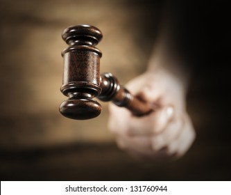 A high quality mahogany wooden gavel. Very short depth-of-field.