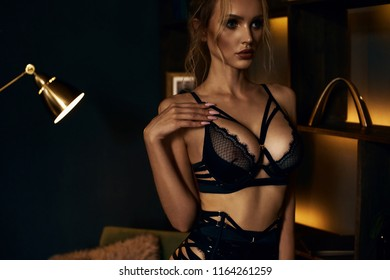 High quality and professional model in dark gold colors almost naked in her lingerie with perfect body