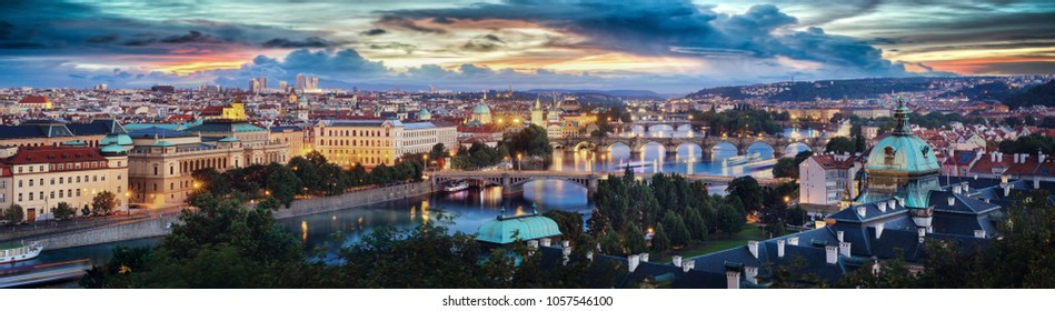 High quality sunset panoramic view of the Charles bridge on Vltava river and Old town in Prague, Czech republic.