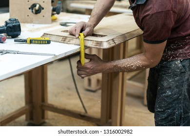 High quality wood concept. Profile side view cropped photo of cabinetmaker handcraft fix wood on table make furniture in garage or workroom